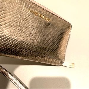 Michael Kors Bags - Michael Kors Rose Gold Leather Clutch Wristlet